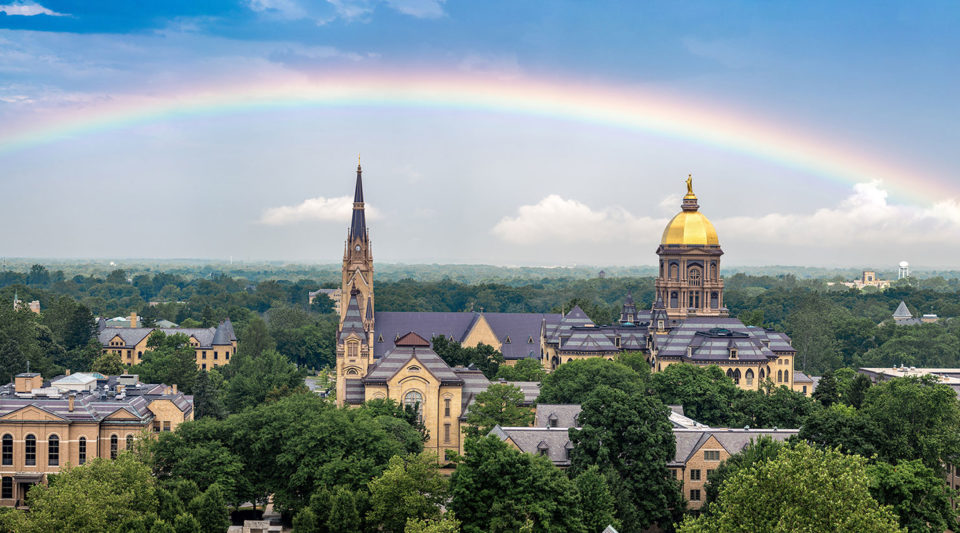 Rainbow over the Basilica and the Golden Dome (Main Building) on campus